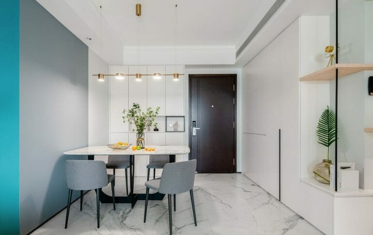 The dining room has a small dining table for 4 people and decorative lights