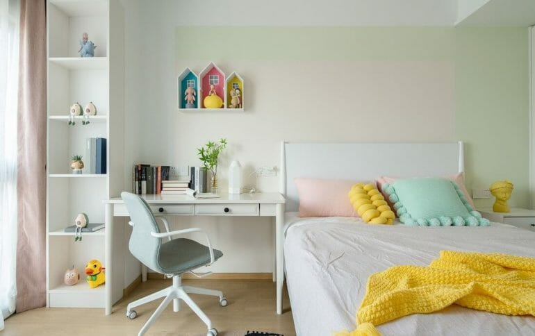 Small desks for children and shelves for books and toys