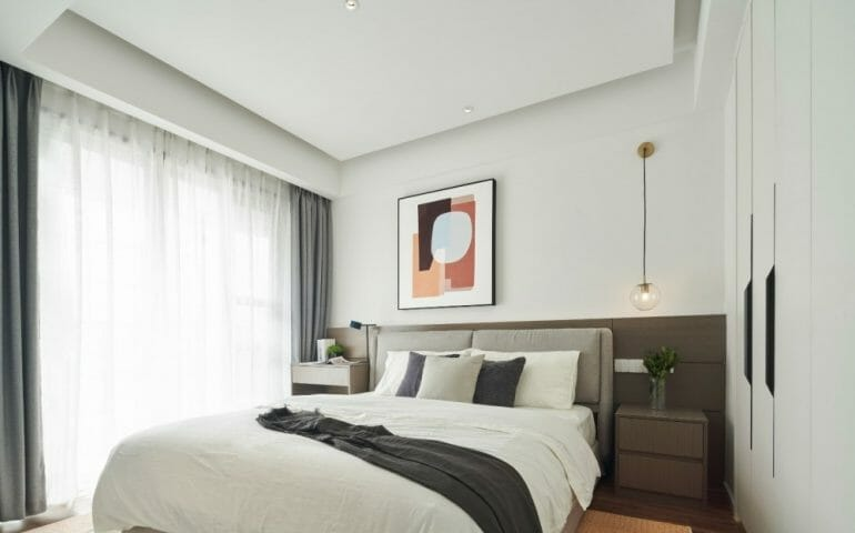 The master bedroom has a minimalist design with a large bed, two shelves for small decorations, and a wall mural