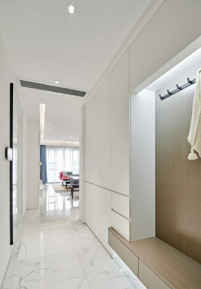 the corridor of the floor is covered with shiny stone glass tiles, industrial wooden cabinets and large mirrors