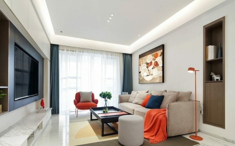 The common living area is covered with glass tiles and plaster ceiling with black leds and ceiling lights