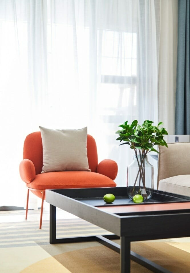 Lazy small orange sofa can sit relax reading book