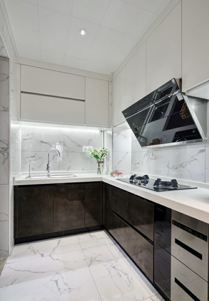 The kitchen is designed with L-shaped wooden kitchen cabinets, the floor is covered with polished glass tiles and fully equipped with cooking facilities.