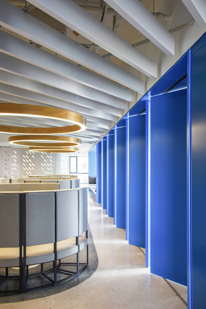 spacious corporate corridor, blue painted plastic folding doors to separate the space