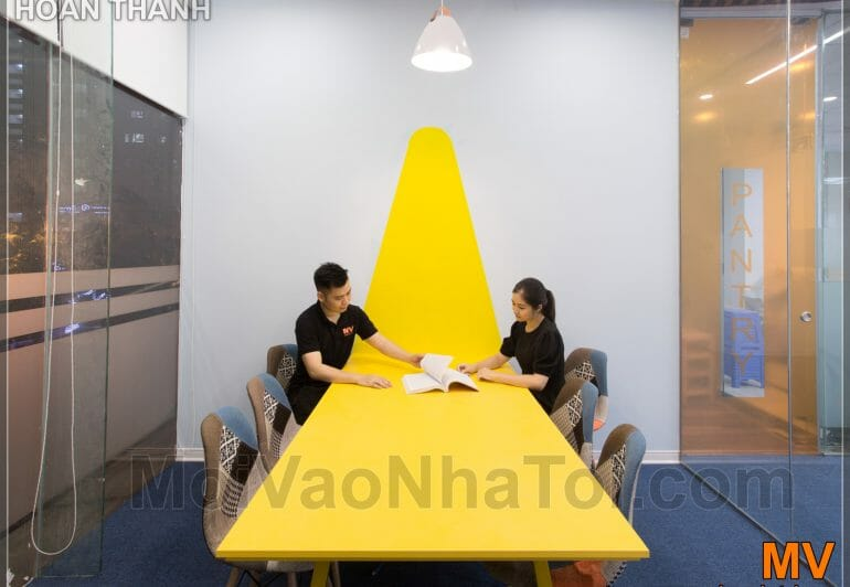 Design and construction of yellow corporate office meeting room