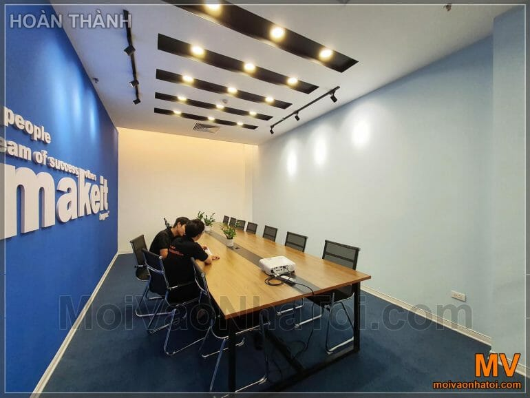 Design and construction of large corporate meeting room in blue color completed