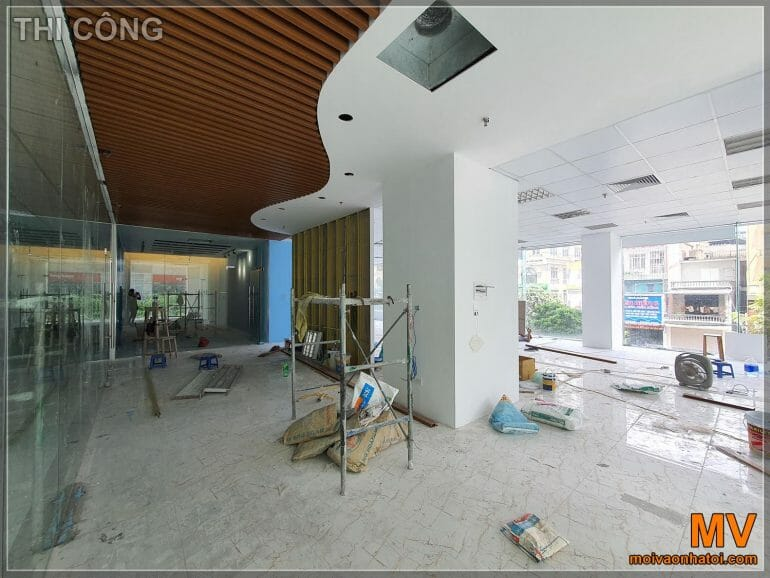 Process of office construction with wood grain plastic ceiling